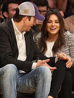 Ashton Kutcher supporting Mila Kunis