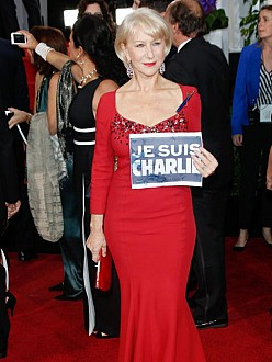 Dame Helen Mirren shows a Je Suis Charlie sign at the Golden Globes