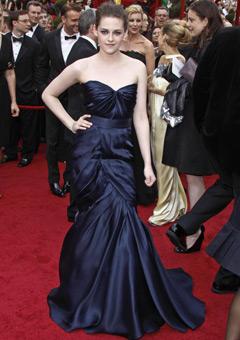 Kristen Stewart wearing a long navy blue Monique
