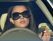 Britney Spears enjoying a smoke in her car while her childrens' custody case is being heard in court