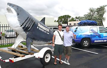 Rob Stewart posing with the 16 foot long Sharkwater fibreglass shark