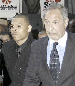 Chris Brown arrives at court with his lawyer