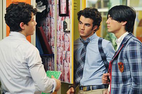 Nick, Kevin (in the middle) and Joe Jonas in their new series, Jonas