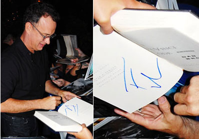 Tom Hanks signing an autograph