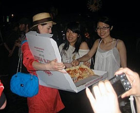 Anne Hathaway serving pizza
