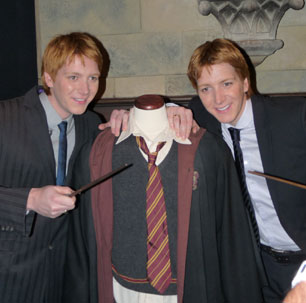 Fred & George Weasley brandish their wands