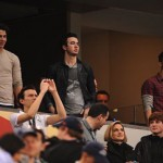 Nick, Kevin and Joe Jonas watched from the stands.