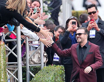Ricky Gervais greets fans as he arrives at The Golden Globe Awards