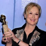 Meryl Streep poses with her win for The Iron Lady