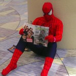 Spidey takes some time off to read the latest issue of Tribute