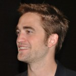 Robert Pattinson enters the room