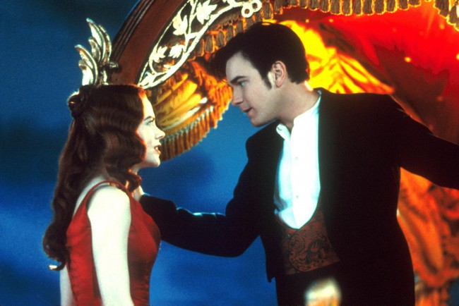 An English poet (Ewan McGregor) travels to Paris, enthralled by the alluring hedonism of the nightclub, Moulin Rouge, where men of all types are entertained by beautiful dancers. However, things take a dark turn when he falls for the club's star (Nicole Kidman), who's already been promised to a jealous duke.
