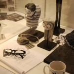 Tim Burton's script and glasses, with kid busts