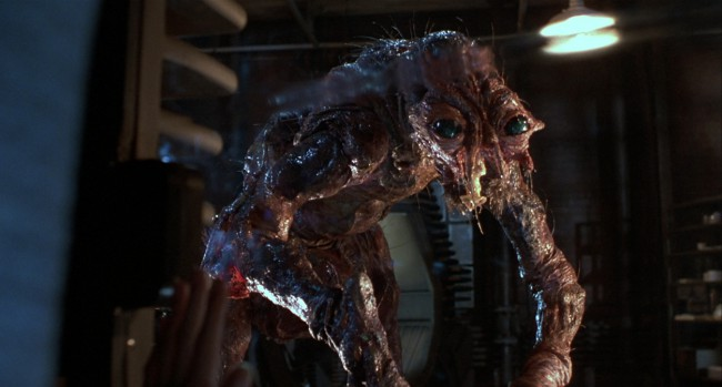David Cronenberg's grisly remake of the 1958 film of the same name, The Fly, essentially takes the premise of the original and follows it through to its natural, extreme conclusion – something not possible at the time of the original's conception, due to technological limitations. Though Cronenberg – along with his co-author Charles Edward Pogue […]