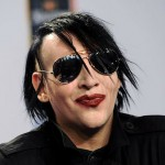 Marilyn Manson writes obscenity across his face at LAX