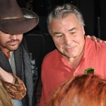 Billy Ray Cyrus and George Chuvalo pose for fans