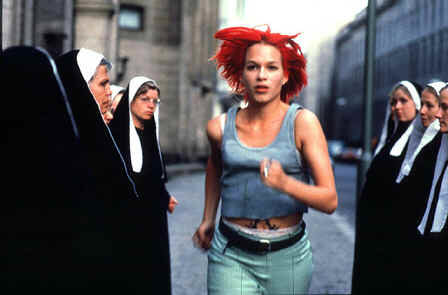 Writer/director Tom Tykwer's 1998 German time travel/ crime film tells the story of Lola. Our heroine Lola (Franka Potente) has about 20 minutes to get 100,000 marks to her boyfriend who is being held captive by the ruthless crime lord to whom he is indebted. What makes Run Lola Run so cool is Tykwer's delivery: […]