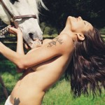 Horse suckles Angelina Jolie's bare breast