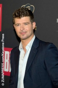 Robin Thicke defends hit song Blurred Lines