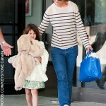Suri Cruise cursed at while exiting hotel