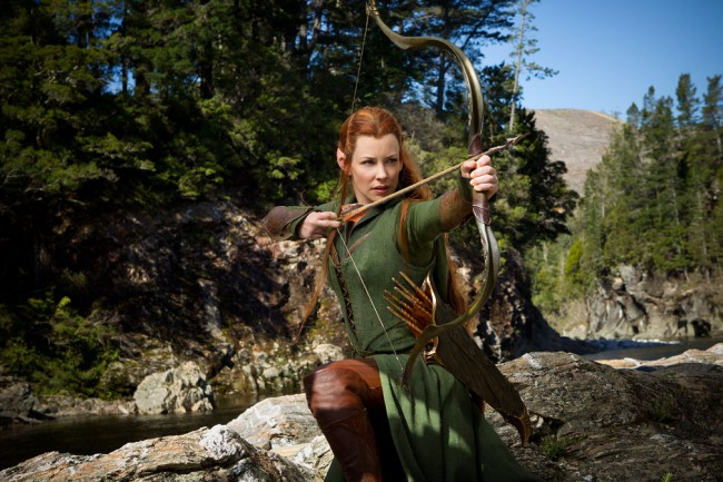 "The trilogy welcomes newcomer Evangeline Lilly, who plays Tauriel, the fearless leader of the Elven Guard. A Silvan Elf, she is regarded as being of a much lower order than other Elves featured in Peter Jackson's Tolkien adaptations, including Elrond, Galadriel, and Legolas. A Woodland Elf of the Mirkwood Forest, her name means ""Daughter of […]"
