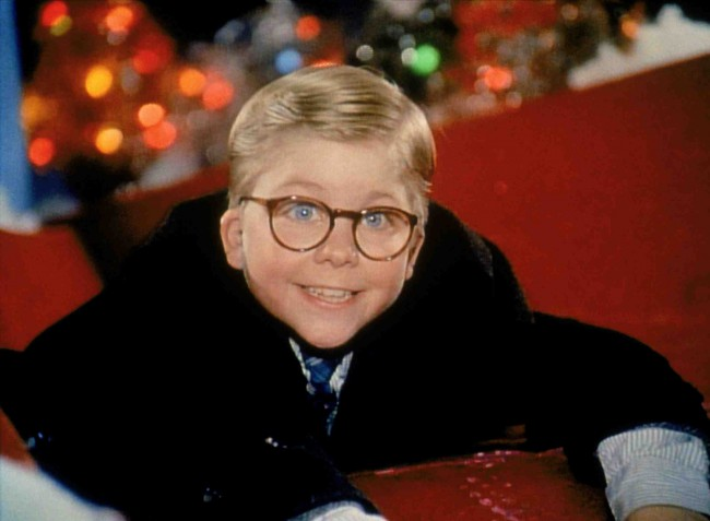 """Set in the 1940s, A Christmas Story introduces us to nine-year-old Ralphie (Peter Billingsley), who only wants a BB rifle for Christmas. His mother tells him, """"No, you'll shoot your eye out."""" It's a phrase Ralphie will hear often during this movie. He receives the same opposition from his teacher and the local Santa Claus. […]"""
