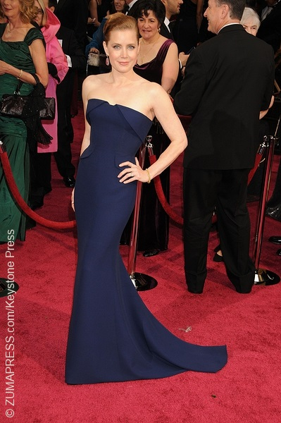 The American Hustle actress chose to sport a strapless Gucci gown. She kept it simple with Tiffany & Co. clutch and jewelry.