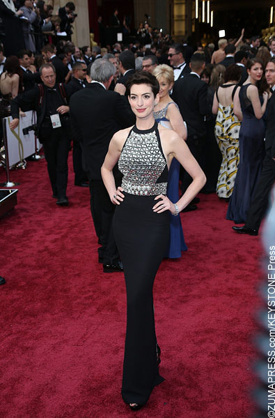 Wearing what many have described as a bedazzled breastplate to this year's Oscars, Anne Hathaway wore a black gown by Gucci. While the overall dress accentuated her figure, the embellishments on the front were quite distracting from the overall look.