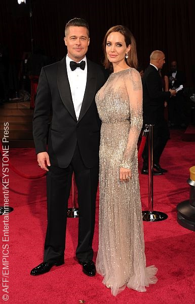 Powerhouse couple Brad Pitt and Angelina Jolie looked fashion savvy at the Oscars. Angelina chose an Elie Saab Haute Couture gown accessorized with 42 carat diamond earrings while Brad suited up in Tom Ford.