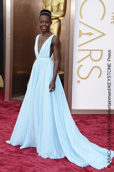 Best Supporting Actress winner Lupita looked dazzling in a cream blue Prada gown.