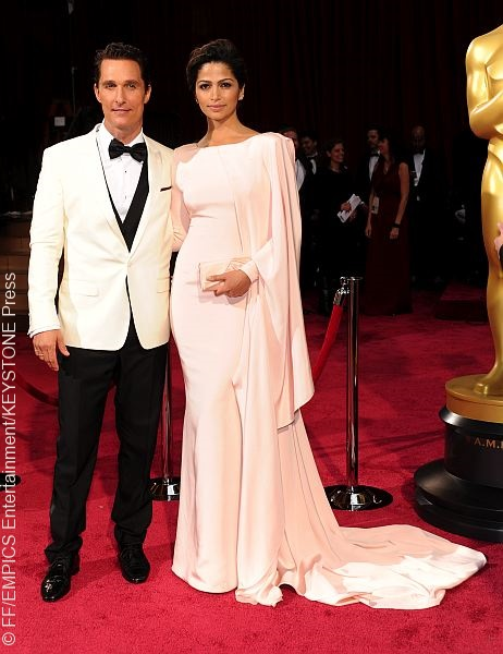 Best actor winner Matthew McConaughey also triumphed on the red carpet, sporting a white Dolce & Gabbana jacket and satin bow tie. His beautiful wife, Camilla Alves, wore a long-sleeved pink gown that had a trail along one shoulder.