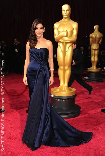 Gravity actress Sandra Bullock chose to knock out her competition in the fashion category, sporting a navy Alexander McQueen gown that was simply breathtaking. The sweetheart neckline and side-swept curls scored her brownie points on the red carpet.