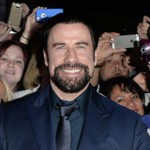 John Travolta poses with fans at The Forger TIFF premiere