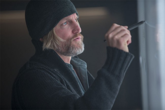 """When Haymitch made his """"presentation"""" of Katniss' most inspiring moments, his banter with an enthusiastic Effie had us laughing in our seats."""