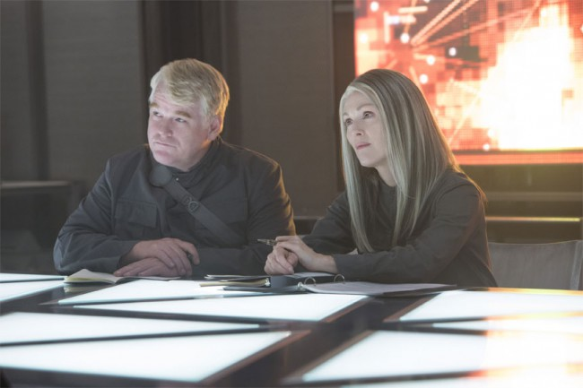 Plutarch's smile when Katniss finally showed the true qualities of the Mockingjay as she stood up to President Coin.