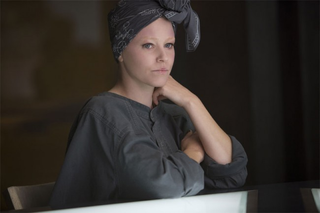 Effie stole our hearts in this film, where even the drab grey garments in District 13 couldn't stop her from being the most fabulous woman in the room.