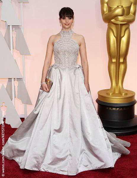 It's hard to tell if Felicity Jones is going to the Oscars, a quinceañera or prom. Her Alexander McQueen dress seems to have meshed multiple looks into one. The lower half could pass for drapery that needs a run-through with a steamer.