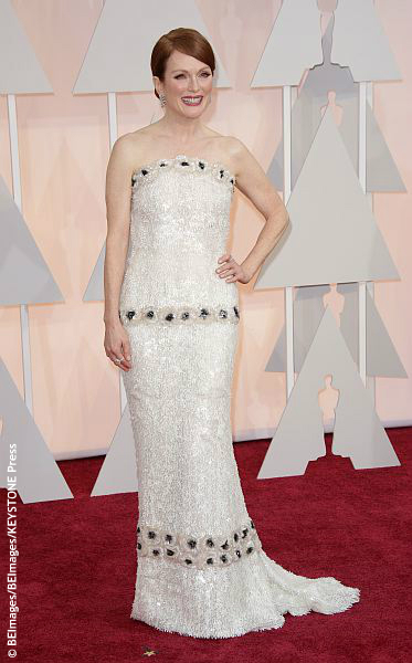 We wish she had chosen a color that popped against her skin and made a statement, considering her Chanel dress took 927 hours to design. There was no wow factor and the mid-dress embellishment would have looked better placed at her waist to give her a shape that was more curvy and less boxy. It […]
