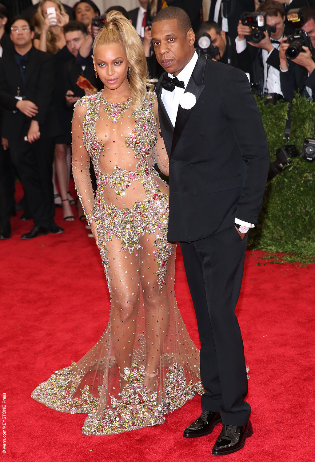 Beyoncé showed off her curves, walking the red carpet with husband Jay Z. She rocked a curled high ponytail and a sheer Givenchy gown, adorned with floral appliques and stones covering the parts that needed to be covered.