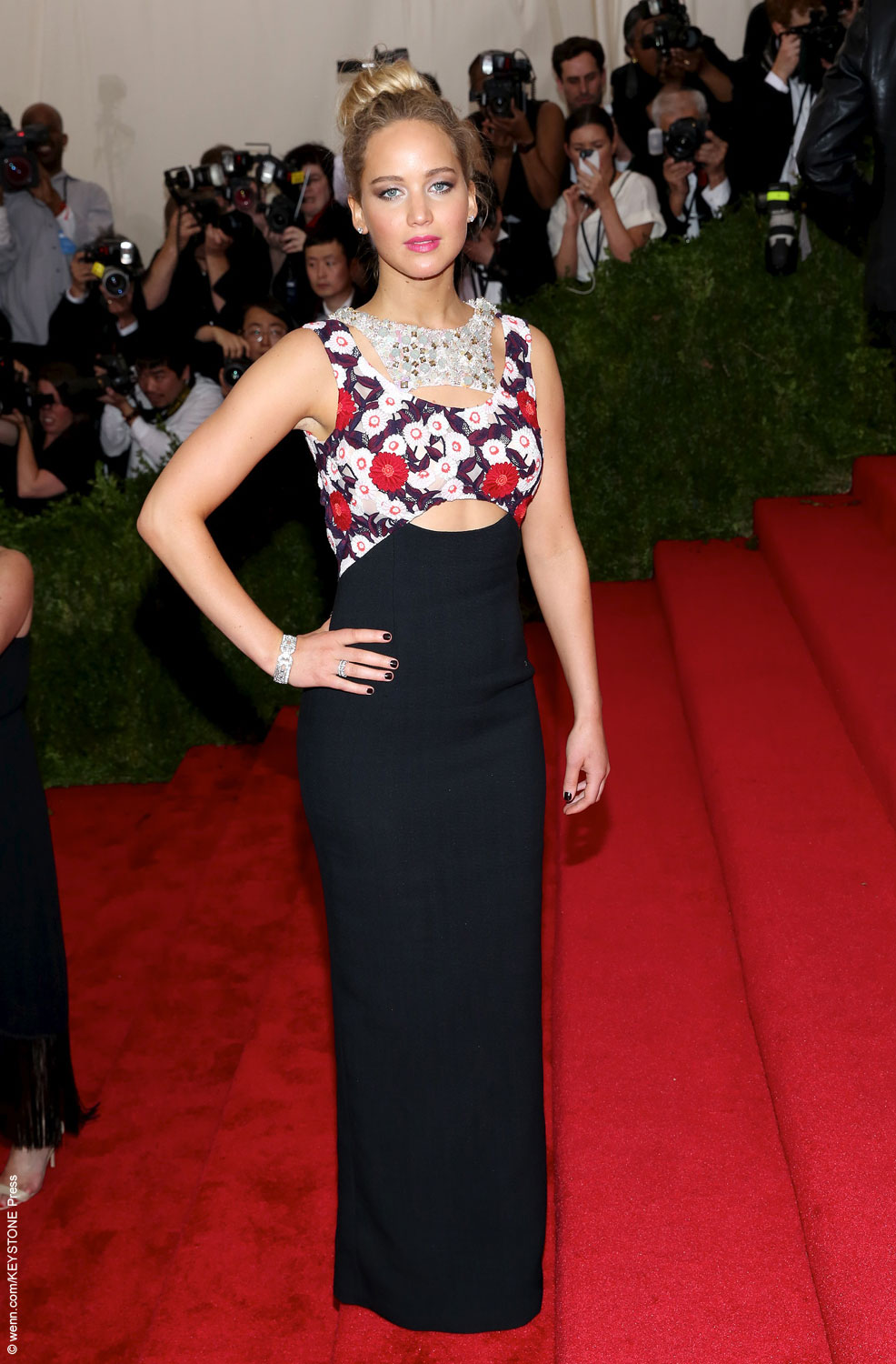 Jennifer Lawrence, co-chair of this year's Met Gala, showed up on the red carpet looking stunning in a Dior Couture floral and black dress. Her bronzed skin, pink lips and blonde locks pulled back into a topknot completed her spring look perfectly.