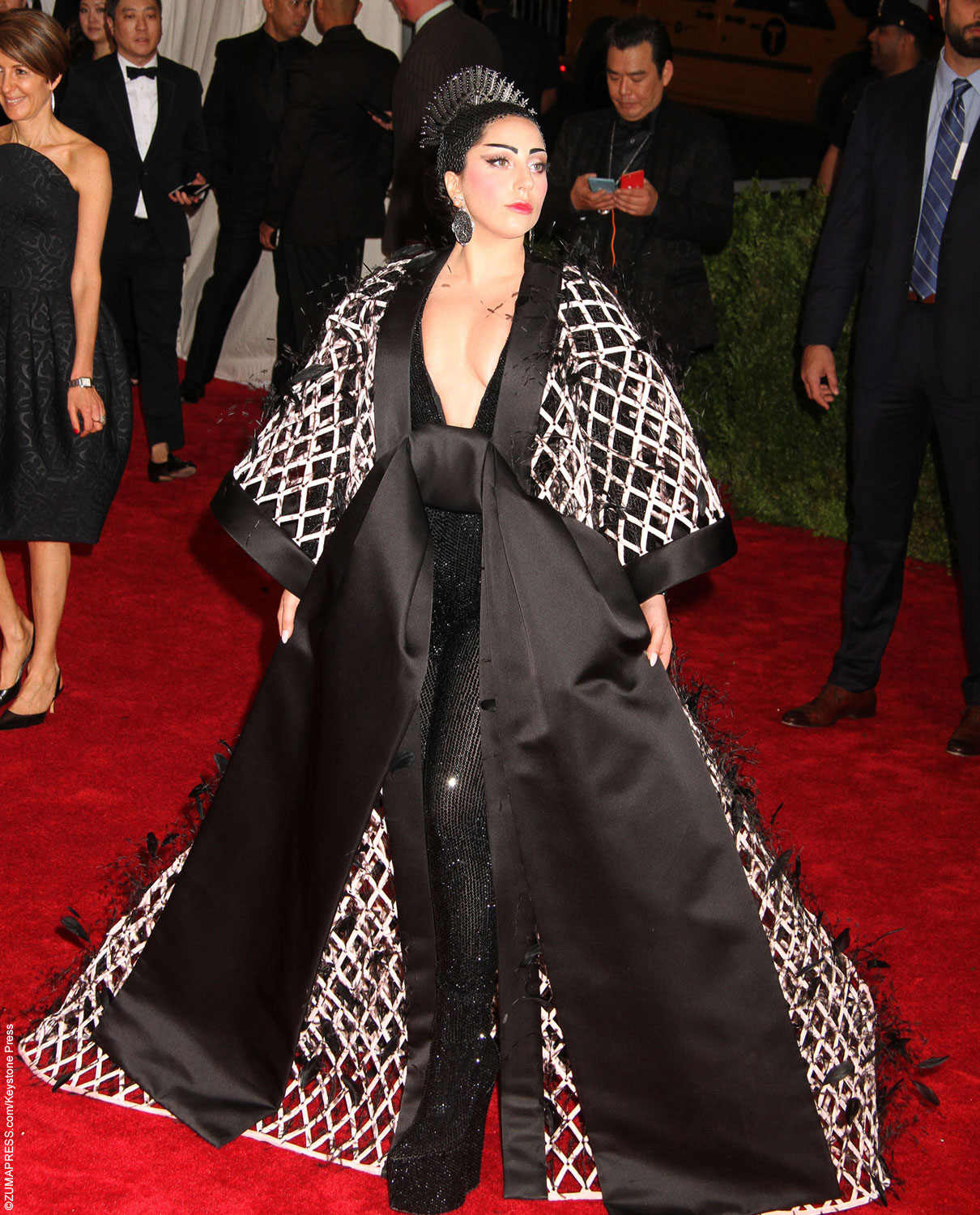 Of course, Lady Gaga made a statement at the Met Gala. Wearing an Alexander Wang bodysuit and cape paired with a lavish headpiece, this look could be considered one of the more tone-downed that Gaga has worn. Lady Gaga worked the red carpet and posed with the designer of her gown for photos.