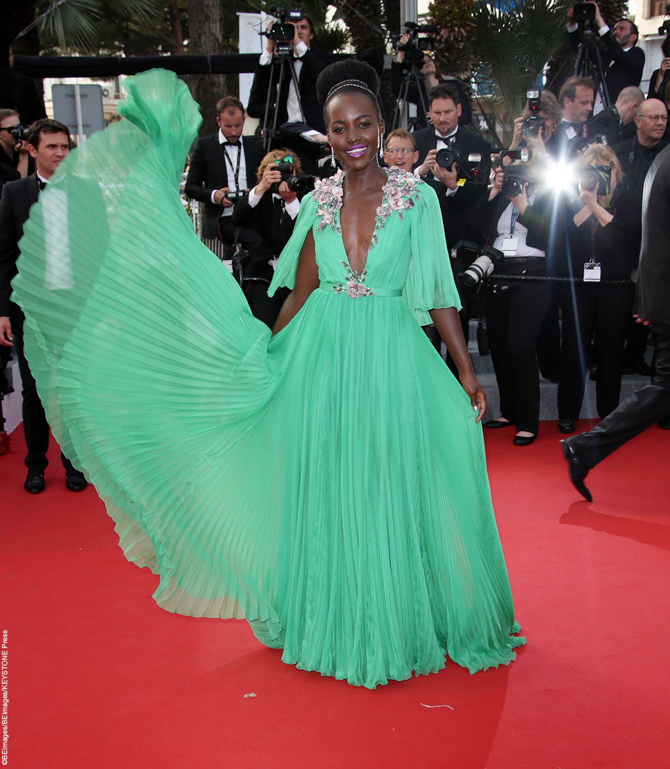 Style icon Lupita Nyong'o did not disappoint at this year's Cannes Film Festival. The beauty showed up in a breathtaking jade chiffon Gucci dress. The Oscar winner is not one to shy away from bright colors and looks absolutely amazing in her eye-catching dress and bright pink lipstick.