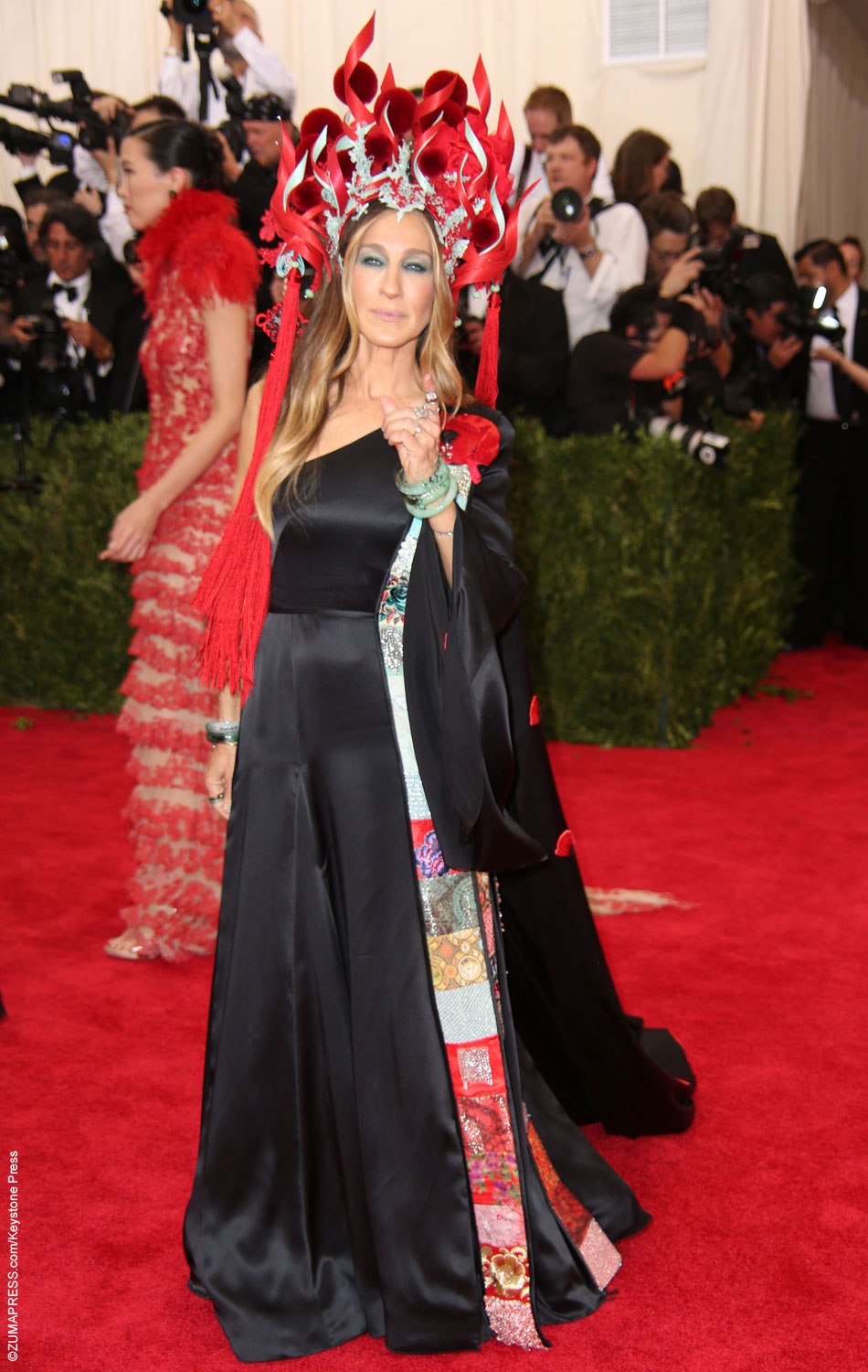 Fashion mogul Sarah Jessica Parker did not disappoint. Her custom made dress and Philip Tracey hat fit this year's theme, China: Through the Looking Glass, brilliantly. Accompanied by Andy Cohen, SJP looked as bold and eccentric as one would hope she would.
