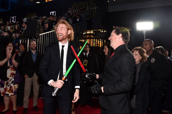 Domhnall Gleeson, who plays the the villainous General Huxin Star Wars: The Force Awakens, has fun on the red carpetwith a toy lightsaber, much to the delight of fans.