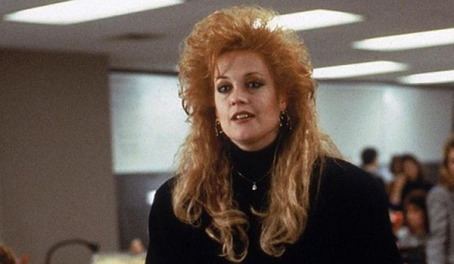 "Yes, it's the '80s. Yes, this was the ""style at the time."" But did it have to be? This is just crazy. How Melanie Griffith got any actual work done in Working Girl with the hair of two different dead people on her head, is beyond comprehension."