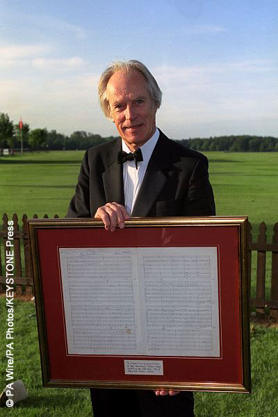 George Martin holding the original score for Eleanor Rigby