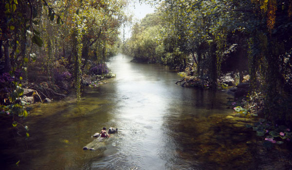 Mowgli and Baloo float down the river in The Jungle Book