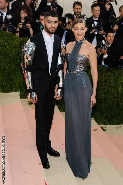 With Gigi Hadid in a silver sequin Tommy Hilfiger dress, medieval breastplate and metallic neckpiece, and Zayn Malik in a Versace armor-esque black tux with robot-inspired sleeves, this 'it' couple took the red carpet by techy storm. Gigi's Mar y Soul manicure, which featured $2,000-worth of hidden crystals, may not have been necessary though.