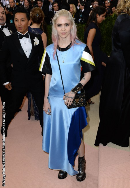 We're all about Grimes' music, but the singer, also in Louis Vuitton, hit all the wrong notes with her oversized satin short-sleeved and drop waist dress. We can't decide if she's trying to look like a teen in need of a shower or if she's channeling Kurt Cobain. Either way, it's an unfortunate misstep.