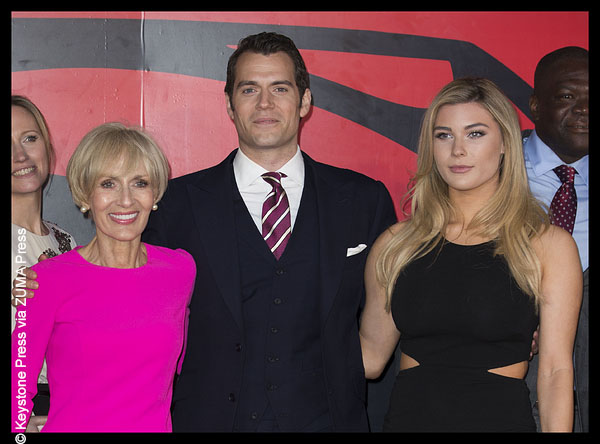 Henry Cavil with Tara King and his mother on the red carpet.